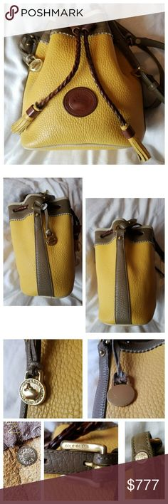 Vintage Dooney & Bourke Mini Teton Drawstring This very rare D&B All-Weather Leather *Mini* Drawstring in Palomino/Bone & Dark Taupe is in pristine vintage condition! Adjustable shoulder strap. Braided leather drawstring. Hanging brass duck fob with original matching fob leather. Intact Dooney tag; Serial #A6152408. This is a vintage bag & does show wear on it; it is NOT a brand new bag, so please ▶LK◀ at all pictures. From my . 〰N TRADES, N HOLDS, N LOWBALL OFFERS〰 Dooney & Bourke Bags Mini…
