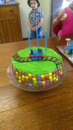 Easy Train or Thomas birthday cake (use liquorice or icing gel for train track, plus choc liquorice bullets, then sitna train on top)