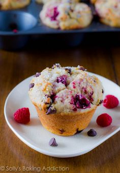 Jumbo Raspberry Chocolate Chip Muffins.  Using a couple tricks to make them extra tall and taste like your favorite bakery-style muffins.  Read how at sallysbakingaddiction.com