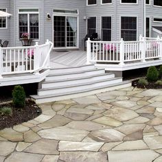 The neutral grays of this flagstone patio complement the gray of the low-maintenance deck, creating a stunning outdoor space and transition. Diy Concrete Patio, Diy Patio, Backyard Patio, Backyard Ideas, Patio Transition Ideas, Flagstone Pavers, Covered Patio Design, Patio Steps, Patio Shade