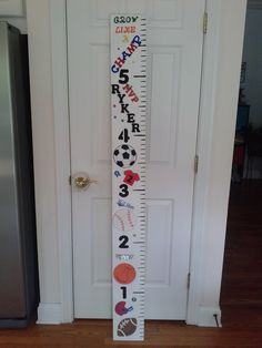DIY Growth Chart Sports theme.  Spray painted board from Lowes, used tape measure and acrylic paint for numbers, glued on wooden embellishments from Hobby Lobby