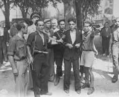 "Members of the French resistance in Aix-en-Provence parade a beaten collaborator through the streets of the city. Collaborators were responsible for the denunciations of untold thousands of Jews and other ""enemies of the Reich"".  Denunciation usually meant internment in a Concentration Camp or immediate execution."