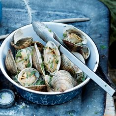 When you toss hot clams right off the grill with some flavored butter, the butter melts and mingles with the clam liquor, creating an irresistible combination.