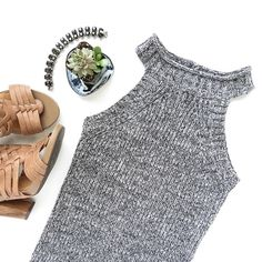 """Fitted knit dress Fitted knit dress in gray. This dress is made of a thick knit in a soft stretchy material. Lightweight enough to wear in the warmer months too.  Fabric content: 60% cotton, 40% acrylic Fit: Young contemporary. Note these run a bit small.  Modeling size S (info: 5'3"""" Dress/top: XS-S)  • Price is firm • Tea n Cup Dresses"""