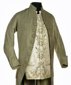 A Gentleman's Frockcoat and Waistcoat, 1770s. The striped green taffeta coat trimmed with 'macaroni' buttons, the waistcoat of ivory embroidered silk.
