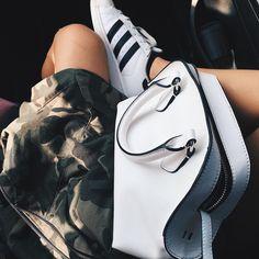 camo jacket + white purse