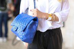 Chanel handbag and Hermes bracelet.  Street Chic NYFW Accessories - New York Fashion Week Accessories - ELLE