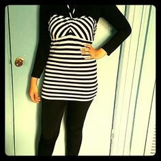 Tie top Black and white stripped top. Top has strings,to be tied around neck. Perfect for summer. Tops Camisoles