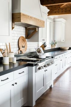 bring the slab surface up the wall a few inches and cap with a ledge. a lovely transitional piece, windowsill and resting place for all your fancy wooden bread boards.