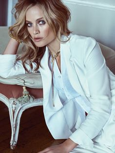 Carolyn Murphy suits up in an all white look featuring a suit jacket and shirting for Vogue Korea Magazine May 2016