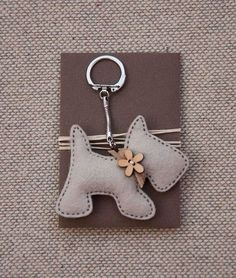 Items similar to Little Dog with a Wooden Flower Button - Keychain Pendant on Etsy crafts crafts crafts decoracion crafts Felt Crafts, Fabric Crafts, Sewing Crafts, Felt Keyring, Felt Dogs, Wooden Flowers, Felt Decorations, Little Puppies, Puppies Puppies