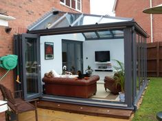 conservatory on bi fold doors opening Modern Conservatory, Conservatory Kitchen, Conservatory Interiors, Garden Room Extensions, House Extensions, House Extension Design, House Design, Extension Ideas, Loft Design