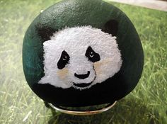 A hand painted Panda on stone or hand painted rock. Stone measures 3 inches wide by 2.5 inches tall. I love painting wildlife on natural