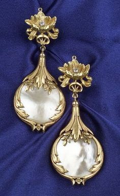 18kt Gold and Pearl Earpendants, early 20th century, each designed as a floral and foliate form suspending blister pearls, bezel-set old European-cut diamond highlight, lg. 2 5/8 in., Continental hallmarks.