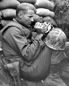 "This photo was taken in Korea in 1953. The little kitten named Miss Hap was only two weeks old. She became an orphan because of war and was rescued by Marine Sergeant Frank Praytor. He adopted the kitten after the mother cat died from the war. According to the marine, the name was derived ""because she was born at the wrong place at the wrong time."""