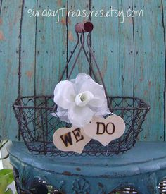 No to the flower and hearts...but I love the idea of using a chicken wire basket for the flower girls or just as decoration at the reception! :)