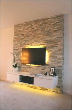 ▷ 1001 + Ideen für Fernsehwand Gestaltungen – Ideen und Tipps tv wall panel stone effects on the wall bastion stones behind the television discreet led lighting in yellow color shelf under the tv Panneau Mural Tv, Tv Wall Panel, Wall Behind Tv, Tv Wanddekor, Modern Tv Wall, Tv Wall Decor, Tv Wall Design, Living Room Tv, Stone Wall Living Room