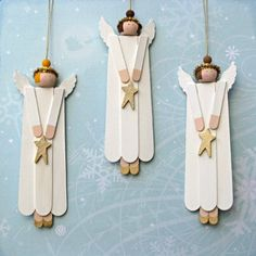Handcrafted wood angel ornaments are made from wood craft sticks, wooden beads, and other wooden components — then handpainted on the front and back with acrylic paints. Sparkling irridescent glitter is on the front of the stars, and front and back of the wings. Halos are made from a metallic gold chenille pipe cleaners. Make wings from white fun foam.