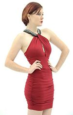 """This Lovely Ruched Mini-dress is sleeveless with a diagonal inline bust that drapes over elegantly on the encrusted collar. It is available in three amazing colors (black, red, and teal). The collar is a mixture of large crystalline gems and small black gems inside quadrilateral rivets. The back features a unique zip down the center. It is truly sexy and alluring.Our model is wearing a Small and 5'9"""" tall with a 34"""" bust, 26.5"""" waist, and 37"""" hips.Details:- Polyester- Spandex- Dry Clean…"""