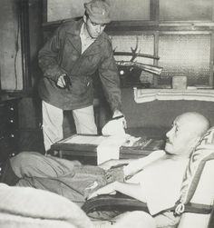Lt. John J. Wilpers confronting Japanese Prime Minister Hideki Tojo moments after Mr. Tojo attempted to kill himself. Lt. Wilpers and five others were sent by Gen. Douglas MacArthur to arrest Mr. Tojo for war crimes. He was arrested and eventually executed on December 23, 1948. Lt. Wilpers died on February 28, 2013 at the age of 93. http://www.obitoftheday.com/post/44617831944/johnjwilpers#