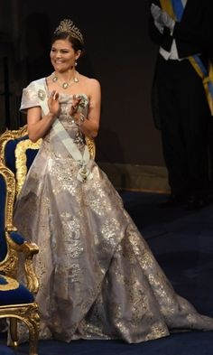 Crown Princess Victoria sparkled in a one-shouldered metallic gown for the Nobel Prize banquet. The future monarch wore her hair pulled back to let the Cut-Steel and Gold tiara.