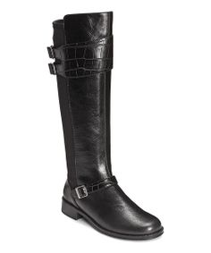 This riding boot amps up style with its decorative buckles and crocodile print. A thick, low heel provides ultimate comfort, while a zipper closure allows for easy removal.