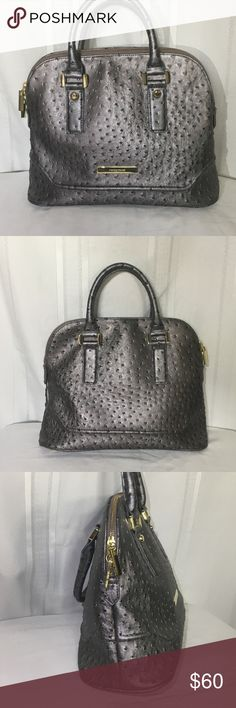 """IVANKA TRUMP Ava Faux-Leather Ostrich Gray Satchel Gunmetal Gray Satchel is pre-owned but like new. Imported faux leather finished in tactile ostrich embossing.  Dual carry handles, 4"""" drop. Top two-way zip closure.  Protective feet. One inner zip pocket, three inner open pockets.  Logo-printed fabric lining 14""""W X 101⁄2""""H X 6""""D Ivanka Trump Bags Satchels"""