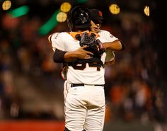 San Francisco Giants starting pitcher Yusmeiro Petit (52) hugs San Francisco Giants catcher Andrew Susac (34) after their 5-1 win against the Arizona Diamondbacks at AT&T Park in San Francisco, Calif., on Tuesday, Sept. 9, 2014.  (Nhat V. Meyer/Bay Area News Group)
