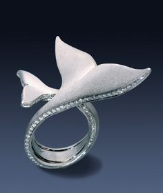 "Ring | Christoph Krähenmann. ""Flukes of Joy; Humpback whale mother plays with her offspring"". White gold with diamonds"