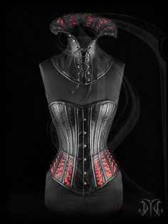 Midbust corset with gothic styled ornamented hip panels over a red satin inlay.    From: US$ 1,380.00