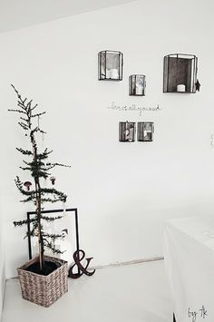 """With just a few well-chosen ornaments and a single strand of lights, a """"Charlie Brown"""" Christmas tree can be made to stand proud! Charlie Brown Christmas Tree, Noel Christmas, Christmas And New Year, Simple Christmas, White Christmas, Christmas Crafts, Christmas Christmas, Beautiful Christmas, Scandinavian Home"""