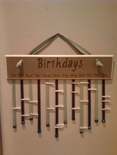 Great Idea and easy to put near calendar area. Could use a paint stick and paint any color along with coordinating ribbon and small clothespins or use thicker ribbon and nametags that can be pinned.