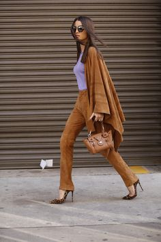 Camila Coelho on her way to Ralph Lauren fashion show wearing a total suede…