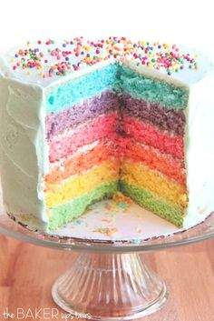 Six Layer Rainbow #Cake from the #Rainbow Desserts Roundup   Rainbow desserts are always bright and fun to make anytime but they are perfect for St. Patrick's Day, birthday parties, and even LGBT Pride Day!