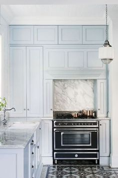 Baby blue cupboards in the kitchen ... LOVE!