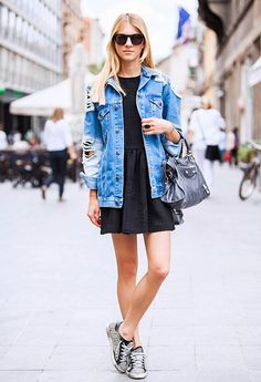 Mix a distressed jean jacket with a sweet mini dress for outfit perfection.