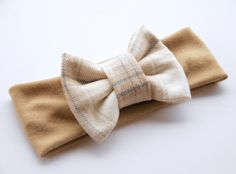 Super soft oatmeal headband with tan, cream and blue plaid bow (bow size is 4.5). Perfect for all ages    Sizes: Newborn- 12 inches  0-3