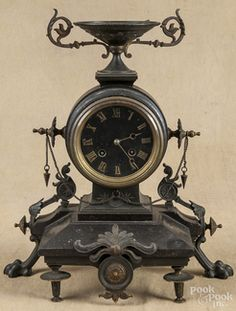 Mantel Clock; Tiffany, Bronze & Iron, Urn Finial, 14 inch.  Year: 	1876 - 1900