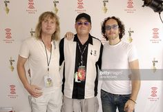 Lou Brutus (center) with Vivian Campbell and Rick Savage of Def Leppard