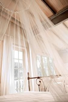 crib canopy diy--this wouldn't work for the photos but might be cute in Gianna's room when she's a little bit older. its a more permanent and sophisticated feel to the canopy than just a hoop and fabric