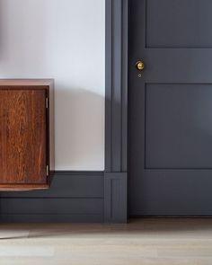 Light Grey Room With Wood Doorframe