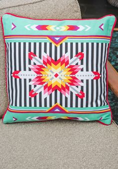 I'm really liking this trend of modified Southwestern decor and patterns.  The worst part about Southwestern style was the boring, over done colors. This however amps it up a ton in a very fun way.  Kaleidoscope of Comfort Pillow, #ModCloth
