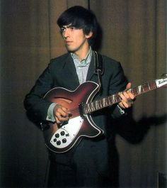 George Harrison with his Rickenbacker 360/12 guitar
