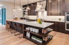 Our Modern Farmhouse kitchen is ready to entertain! #kitchen #modernfarmhouse #island #butcherblock #woodcabinets #metalhood #openshelving #openconcept #farmhousesink