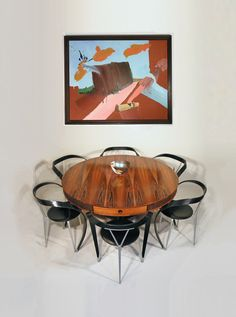 Robert Heritage rosewood drum table with Revers chairs by Andrea Branzi; and original oil on canvas by Fiona Rae. http://www.midcenturyhome.co.uk