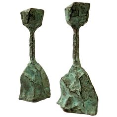 Brutalist Pair of Cast Bronze Candleholders | From a unique collection of antique and modern candle holders at https://www.1stdibs.com/furniture/decorative-objects/candle-holders/