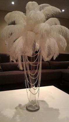 Ostrich Feather Centerpiece with Acrylic and Pearl Garlands for a Vintage Roaring Look! - Informations About Ostrich Feather Centerpiece with Acrylic and Pearl Garlands for a Vintage Roarin - Masquerade Party Decorations, Great Gatsby Party Decorations, Masquerade Theme, 1920s Party Decorations, Pearl Decorations, Harlem Nights Party, Roaring 20s Party, Roaring 20s Wedding, Great Gatsby Wedding