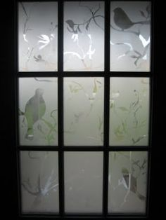 stenciled & frost spray painted front door window-- I love frost spray paint. Already used it in another rental. Adds cute and inexpensive privacy and flair.
