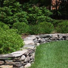 I need one of these stone retaining walls in our backyard, more hardscaping to set off roses and lavender.
