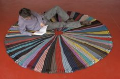 (Product, not pattern) Rug, 90% wool / 10% polyamid,   diameter 250 or 130 cm, available in multico or dark shades  Partly knitted with a recycled woolen yarn.